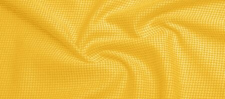 Background texture, pattern Fabric warm wool with a stitched yellow thread. Show your real stripes with our yellow wool knitted. Possessing bright, eclectic colors, exudes a bohemian look.