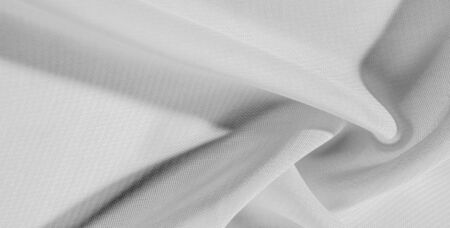 texture background pattern of white silk fabric. This silk organza has a gentle open weave. Use this luxurious fabric for anything from your design for special occasions to creating your projects.