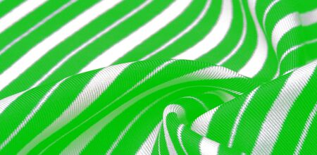 silk striped fabric. green white stripes. This beautiful, super soft, medium-sized silk blend is perfect for your design projects. It is brushed on the back for a luxurious feeling.