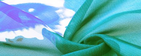 Texture, background, green silk fabric with a blue floral print. Your projects are developed in our studio by designers who have deep knowledge in the use of their final product.