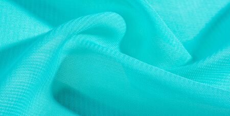 texture background pattern  blue silk fabric. this silk organza has a delicate open weave Use this luxurious fabric for anything from your design for special occasions to the creation of your projects Reklamní fotografie