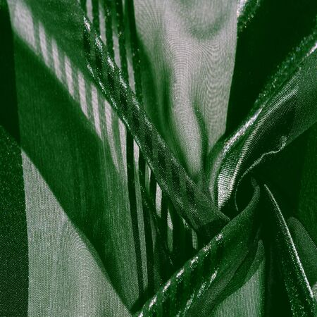 Texture, background, pattern, collection, light transparent silk fabric with stripes of different size, green. exquisite luxury for your holiday!