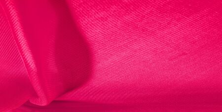 texture background pattern red silk fabric. This silk organza has a gentle open weave. Use this luxurious fabric for anything from your design for special occasions to creating your projects. Reklamní fotografie
