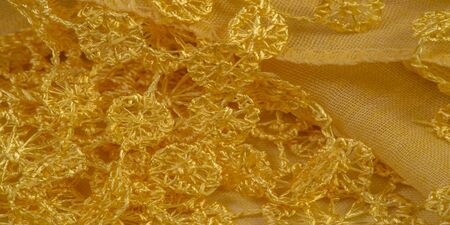 Texture, background, pattern, postcard, silk fabric, female yellow scarf with lace wrappers. Use these fancy images to create your print and digital materials.