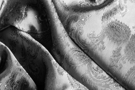 texture, background, black steel gray fabric with a paisley pattern. based on traditional Asian elements