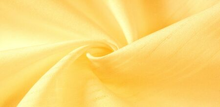 texture background, pattern. silk yellow fabric. From Telio, this organza has a thin, open weave that is thicker and sharper than silk gauze. Use this luxurious fabric for anything. The possibilities are really endless!