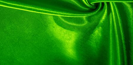 Texture, background, pattern, silk fabric of green color. This adorable, soft and shiny fabric has a smooth mink surface, perfect for creating your projects.