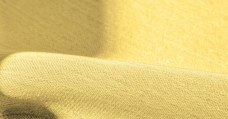 Background, pattern, texture, wallpaper, yellow silk fabric. It has a smooth matte finish. Use this luxurious fabric for anything - from design to your projects. The possibilities are truly endless!