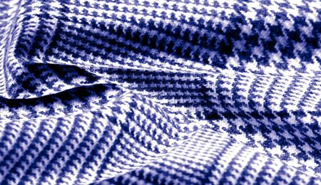 Background texture, pattern. The fabric is thick, warm with a checkered pattern, blue. Stop. You made the right choice by purchasing this photo, your design will be great with this image. Stockfoto