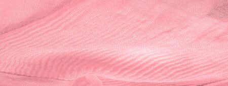 Texture, background, pattern, pink silk corrugated crushed fabric for your projects Archivio Fotografico