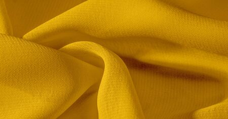 The background, pattern, texture, wallpaper, yellow pale silk fabric has a brilliant shine. This is the most versatile fabric. Be creative with beautiful accents of your design.