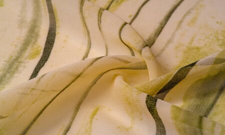 Background texture. Women's olive-colored scarf Photography for your projects from pashmina Stolen shawls, shawls Your projects will be the best, creativity knows no bounds! dare to be the best Zdjęcie Seryjne - 138610430