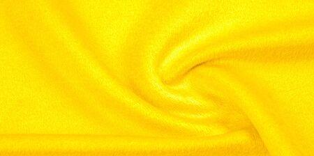 patrón, textura, fondo, lana cálida, tela amarilla. Acerca de Esta tela es bastante fina. Tiene una variedad de hilos con variaciones de color muy pequeñas para una apariencia final clara con un brillo sutil.