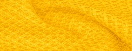 Background texture, pattern. Yellow fabric with metallic sequins. This beautiful lightweight sequined fabric has notes, sequined accents and a beautiful design. It also has a nice sheen.