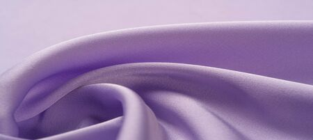 background texture, pattern. Lilac silk fabric.  It is a smooth, matte finish, and it gets its lightness from twisted yarns. designers, love them. The possibilities are really endless!