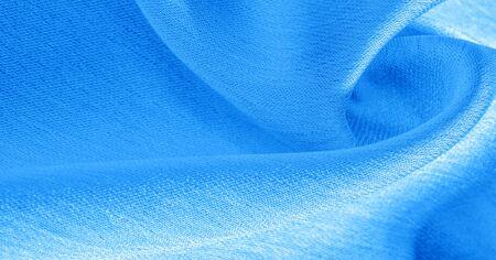 Hintergrund, Muster, Textur, Tapete, blauer Seidenstoff. Es hat ein glattes mattes Finish. Verwenden Sie diesen luxuriösen Stoff für alles - vom Design bis zu Ihren Projekten. Die Möglichkeiten sind wirklich endlos!