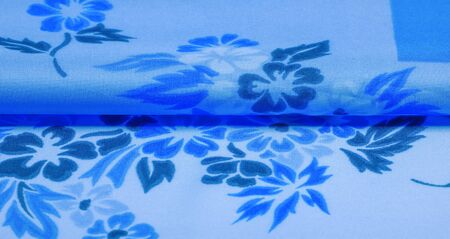 texture, background, pattern, delicate blue silk with floral print Exceptionally lightweight pure silk fabric with a delicate texture. Clean, use lining when opacity is desired.