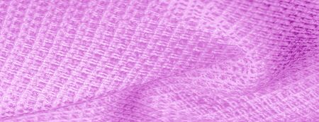 Background texture, pattern. pink fabric with metallic sequins. Die and shine with this dazzling cloth! Perfect for your design and more. The color is a dark rose with shiny pink sparkles.