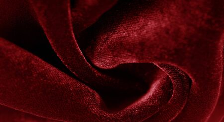 Texture background, pattern. red velveteen. Rock the runway with this beautiful high fashion fabric. This medium weight fabric has a beautiful shine with a velvet face for a feeling of luxury.