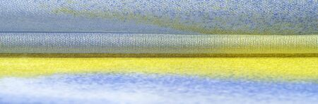 silk fabric of pale blue, yellow and white, abstract pattern and bed tones. We are woven according to customer requirements.