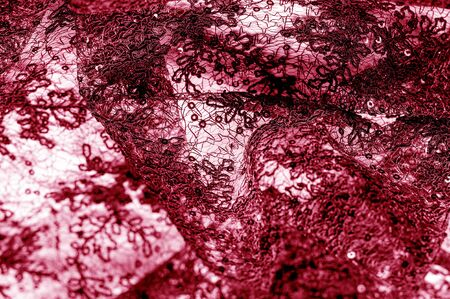 Texture, pattern, lace fabric in red on a white background. Delicate and classic, this sheer lace has no significant stretch and pearlescent shine. Suitable for your design wallpapers and posters