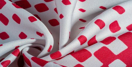 texture background pattern. silk fabric with a pattern of red squares on a white background. This is a heavy square 100% polyester pattern that fits perfectly with modern