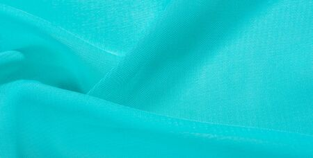 texture background pattern  blue silk fabric. this silk organza has a delicate open weave Use this luxurious fabric for anything from your design for special occasions to the creation of your projects Archivio Fotografico