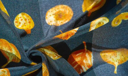 Silk fabric, blue with a print of autumn leaves of yellow color. The photo is intended for, interior, imitation, fashion designer, marketing, architecture, sketch, layout, entourage 写真素材