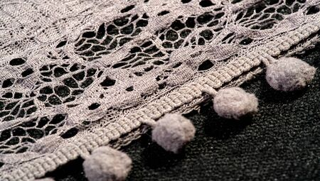 Texture background, female lace scarf. Arrived quickly and beautifully, silver color. The scarf is thin but very attractive and very well made with no loose yarn or loose parts. Фото со стока