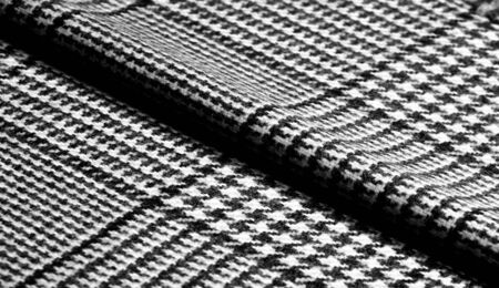 Background texture, pattern. The fabric is thick, warm with a checkered pattern, gray black. This is an unforgettable encounter with my fabric. The best design solutions are waiting for you.