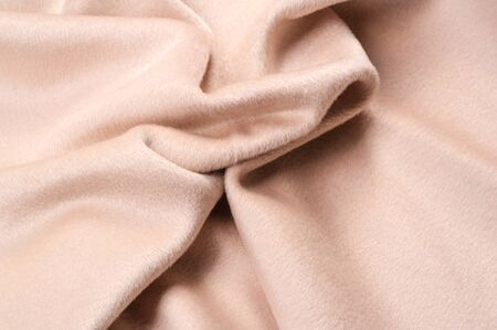 Texture, background, pattern. Fabric warm wool, beige, pastel sleep for autumn and winter, and your design. Thick with heavy weight, this is an excellent choice for your creativity Imagens