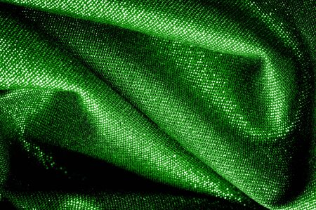 Texture, background, pattern. The fabric is Dark green coated with a metallic silver thread. These fabrics are ideal for any project, wallpaper, all design solutions. and many uses of ships