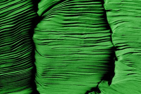 Texture, background, pattern, Fabric silk pleated green. This beautiful quality fabric has an excellent corrugated wrinkled texture, drape and semi-curved. Ideal for making your design Zdjęcie Seryjne - 138630287