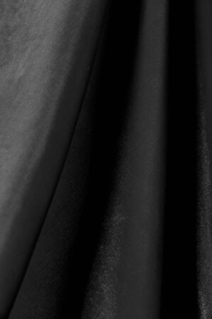 texture, background, pattern. Black silk fabric. It is black and heat resistant with gray. Transform its tougher drape into a design for any event. It is a crispy, lightly textured hand. Reklamní fotografie