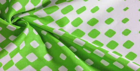 texture background pattern. Silk fabric with a pattern of green squares on a white background. This is a heavy square 100% polyester pattern that fits perfectly with modern, transitional or contemporary design.