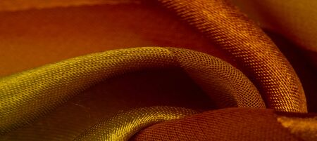 Texture, background, yellow silk striped fabric with a metallic sheen. If you have a bad mood, this fabric will lift it to unprecedented heights. Your project will be successful.