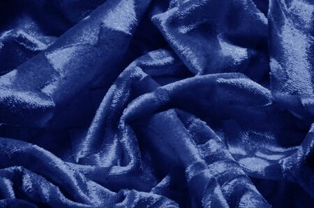 Texture background pattern velor cloth of blue color Velvet is synonymous with luxury One of the most characteristic qualities of velvet is its soft fuzzy heap Pile makes velvet smooth rich in texture