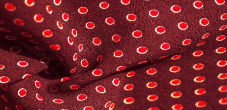 Texture background, pattern, red silk fabric with red polka dots. Light and silky-soft satin pendant is perfect for your design, online projects. It is also perfect for screensavers and wallpapers Banco de Imagens