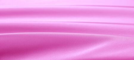 texture. Pink silk fabric. brilliant luster and characteristic small blinds that run horizontally throughout the fabric It falls into soft folds when draped and is the most versatile fabric we carry 版權商用圖片
