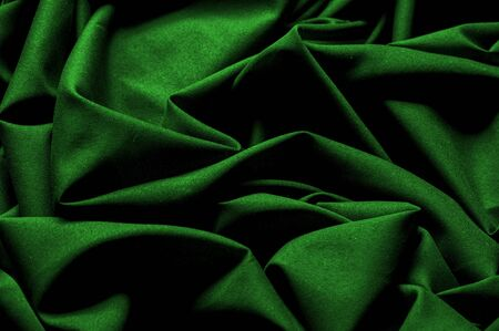 Textured, background, pattern, green fabric. Alpine upholstery Velvet hunter Green patio. This fabric - your decision in design, will give your page on the Internet a not forgetful foreshortening 스톡 콘텐츠