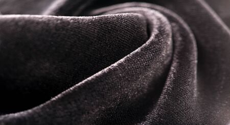Texture background, pattern. Black Velveteen. This magnificent elastic velor fabric has a velvety nap. Pan pan adds shine and texture! It has a knitted back and is great for your design.