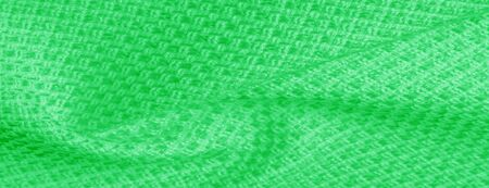 Background texture pattern Green fabric with metallic sequins This elegant and luxurious chic fabric is distinguished by sparkles of decorations. Ideal for special occasions overlay illusions designs Reklamní fotografie