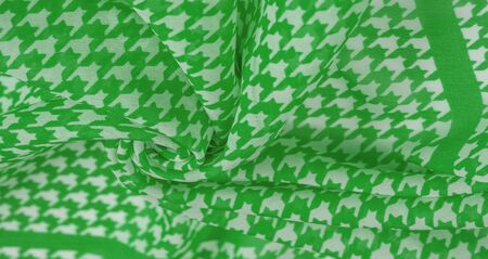 Texture, background, pattern, silk fabric, the brightness of green color on a white background. Pattern on the fabric ala famous French fashion designer. projects will fulfill your desires you are known