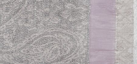 Texture background, pattern. white brocade fabric. Organza brocade fabric - shepherd, with a crunchy palm. It has a large yarn-dyed flower embroidered pattern throughout.