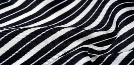 silk striped fabric. Black and white stripes. This beautiful, super soft silk blend of medium thick woven fabric is perfect for your design projects. It is brushed on the back for a luxurious feel