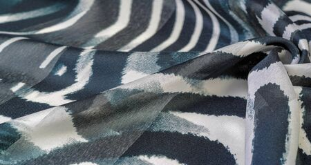 TeTexture pattern, silk fabric, African themes, printing on fabric, cheerful pattern will decorate the project. dichotomous nature of the theme of freedom, heaven, hell, exotic banality, dream reality Banco de Imagens