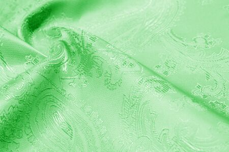 Texture background Fabric silk green Slim and light, add it to your design, inspired by the runway. It has a smooth, clear hand and a slightly transparent opacity, allowing the lining to be optional.