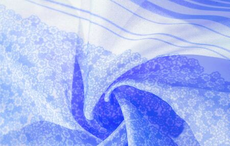 Texture, pattern, blue silk fabric on a white background, flowers pattern silhouette on white background decorative course, postcard wallpaper design. Your project will be successful. Act inspired