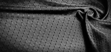 Background texture, pattern. Black silk fabric with a small checkered pattern. You do not need smoke and mirrors, this Katia smoky gray checkered SILK yarn speaks for itself. creates airy fabric