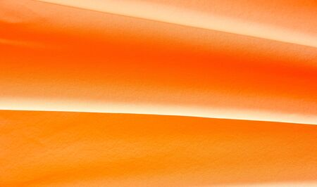 Picture Texture, background Orange silk fabric. It has a wonderful shine with slight color variations to give the look a strip in the fabric. Ideal for adding a touch of luxury to your decor projects